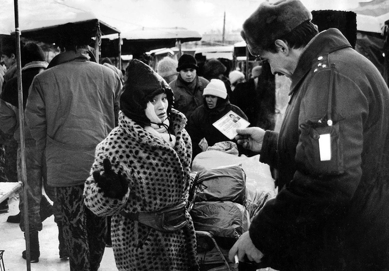 Checking passports at a market