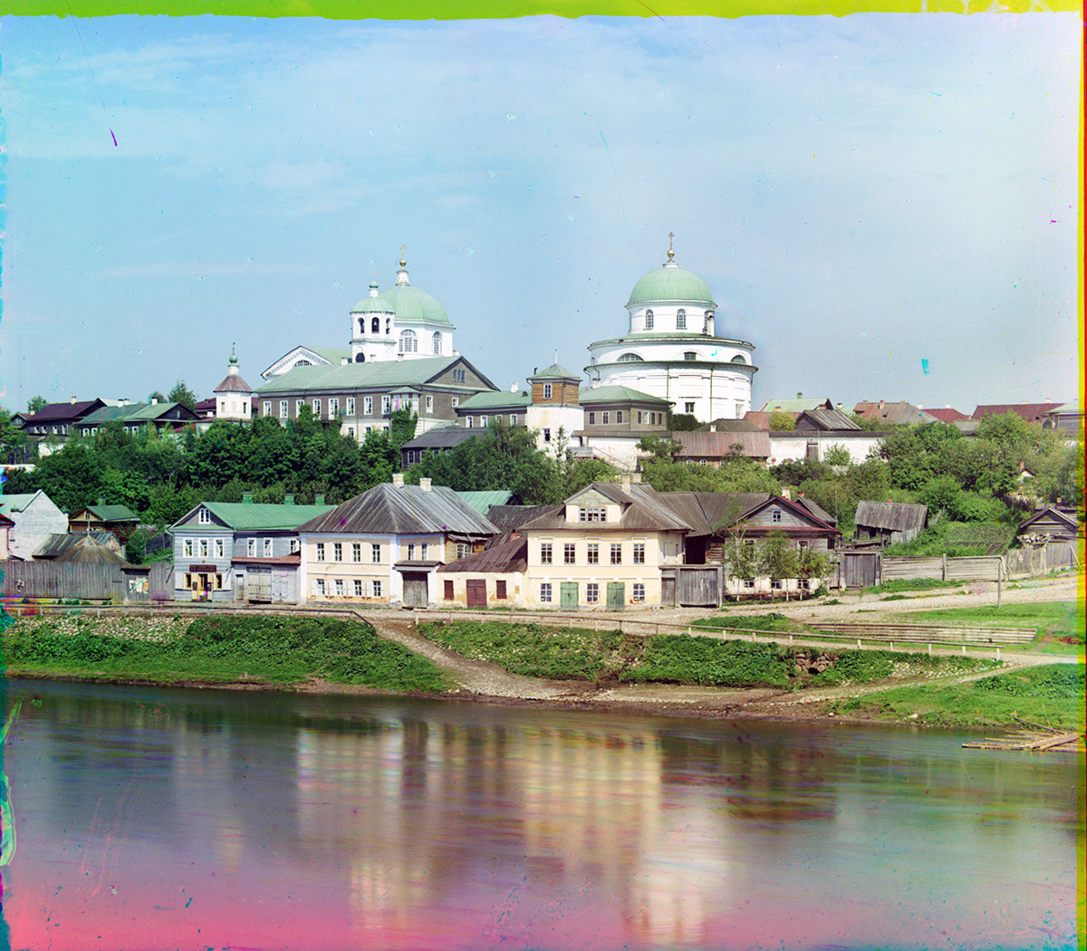 Torzhok. View east from Novgorod Embankment across Tvertsa River. Top: Resurrection Convent with Resurrection Cathedral (left) & Church of Decapitation of John the Baptist. Summer 1910