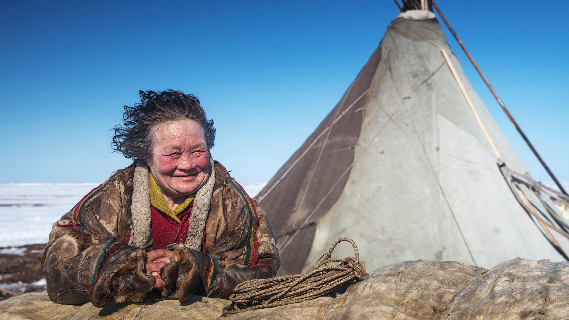 A reindeer herder women looks on at a nomad camp at 150 km from the town of Salekhard, Yamalo-Nenets Autonomous Okrug, May 2, 2016.