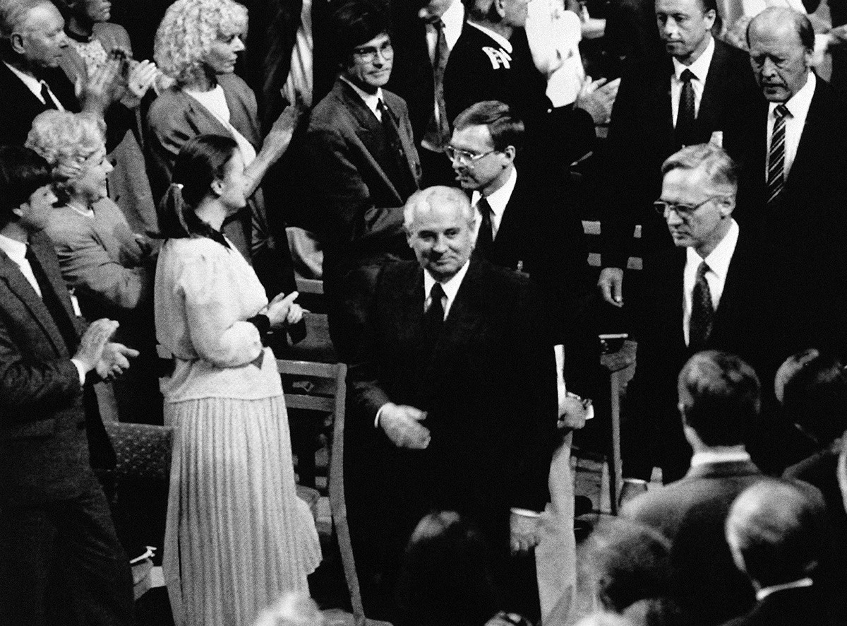 Mikhail Gorbachev enters the lecture hall to deliver his long-delayed Nobel Peace lecture.