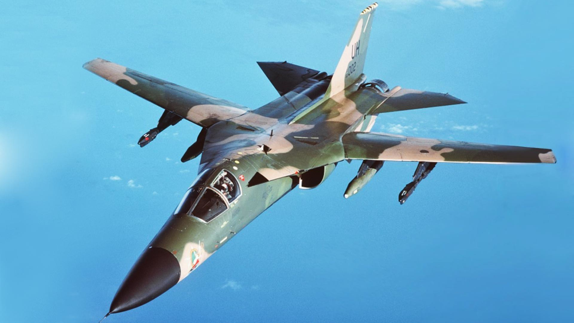 An air-to-air left front view of an F-111 aircraft during a refueling mission over the North Sea.