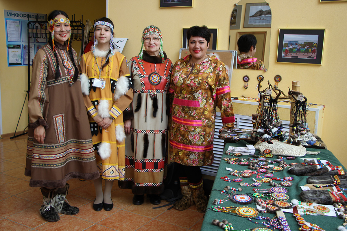 Left to right: Ksenia Kiyaikina, a dancer at the local ensemble, Diana Shumkova, a student of the Aleutian weaving class, Nina Kiyaikina, a teacher of this class, Galina Korolyeva, chairman of the Aleutsky Municipal District duma.