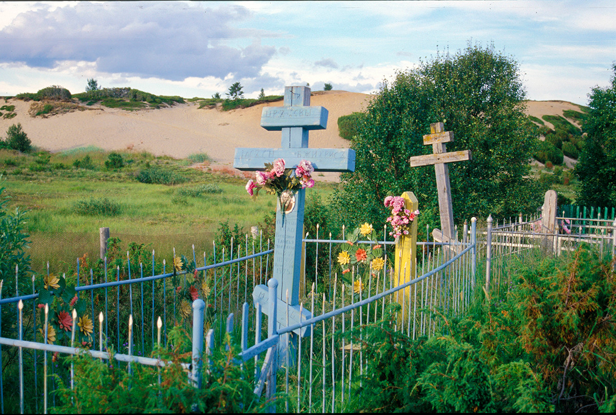 Varzuga cemetery on left bank. Background: sand dunes with juniper bushes.  July 21, 2001