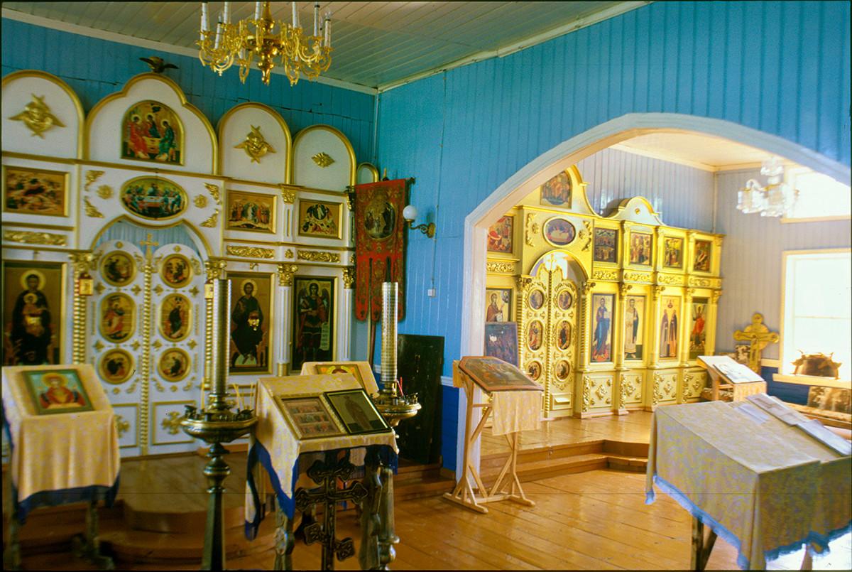 Varzuga. Church of St. Athanasius of Alexandria. Interior with icon screens at altars dedicated to St. Athanasius & to Sts. Zosima & Savvaty. July 21, 2001