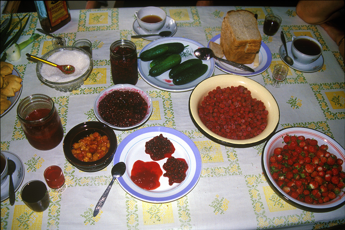Kimzha. Kitchen table at Lidia Ivanovna's house. Forest berries, garden produce, jams, preserves, kisel, mors--all gathered & produced by Lidia Ivanovna & friends. August 2, 2000
