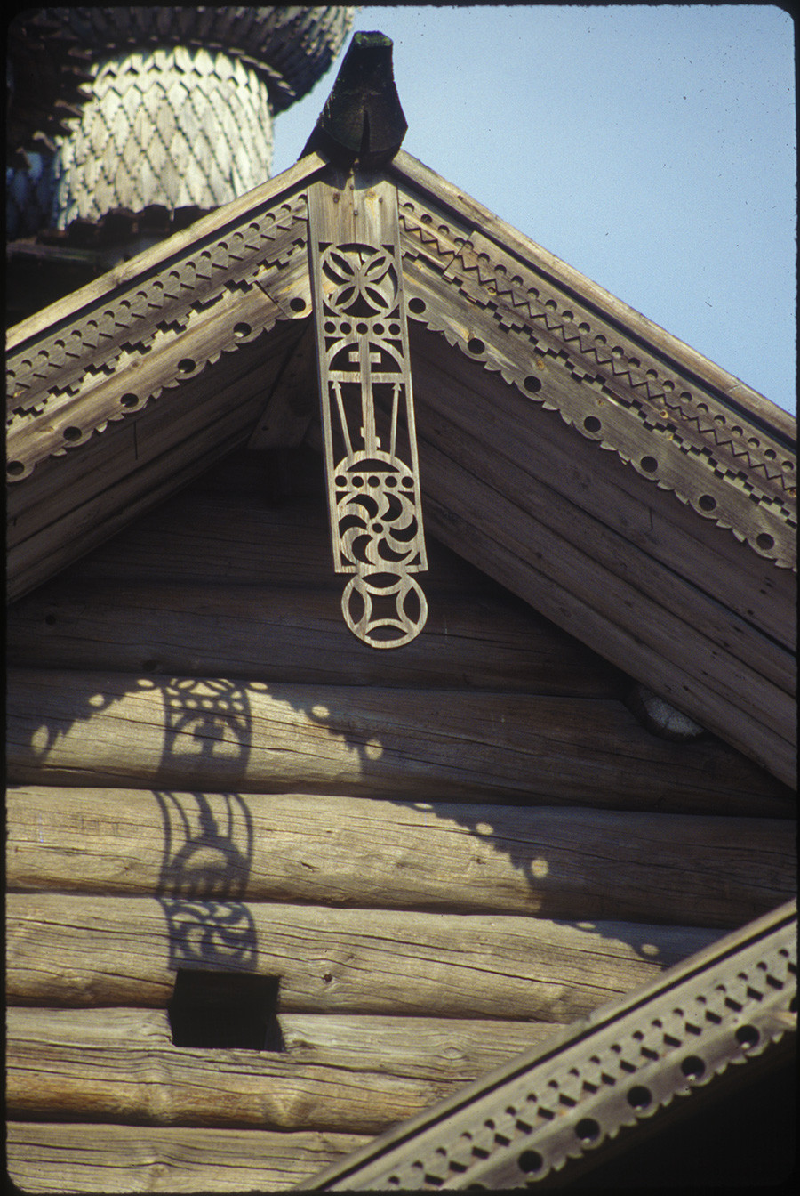 Church of the Intercession. West facade with decorative carving (solar sign, cross & Instruments of Christ's Passion). August 6, 1991