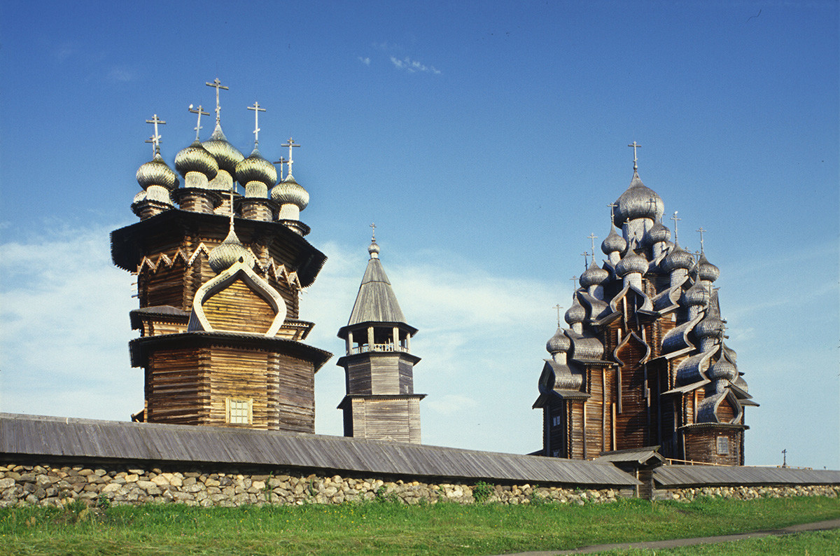 Kizhi pogost. Southeast view with fieldstone wall. From left: Church of the Intercession, bell tower, Church of the Transfiguration. July 13, 2007
