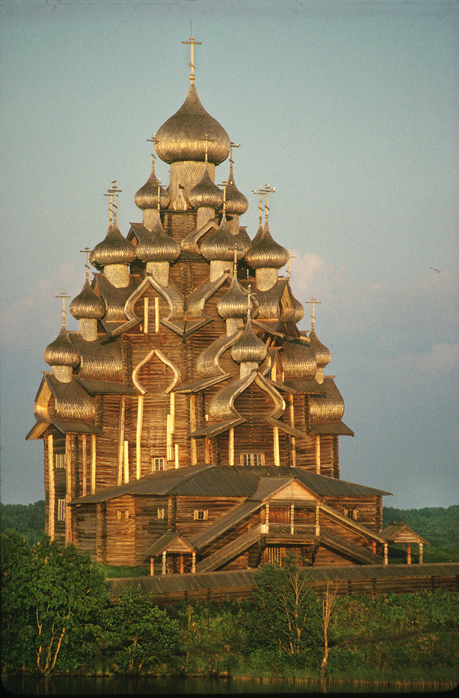 Church of the Transfiguration. Northwest view in late evening sunlight after thunderstorm. August 6, 1991