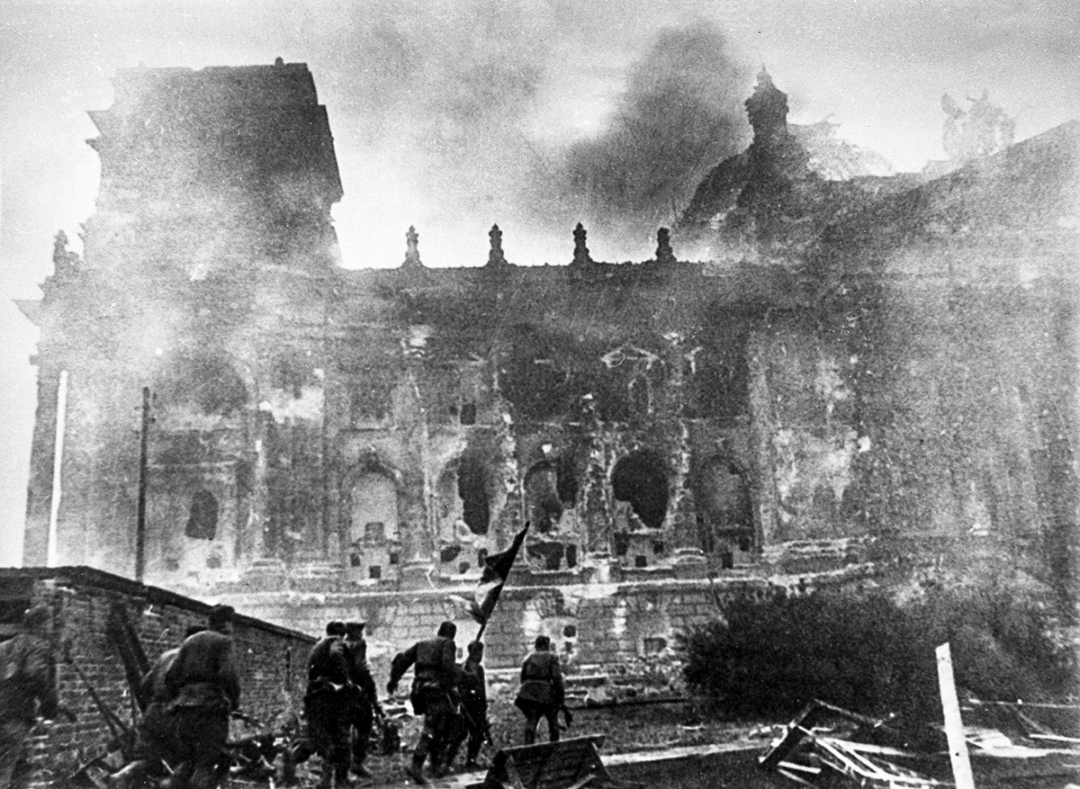 Soviet troops storm the Reichstag.