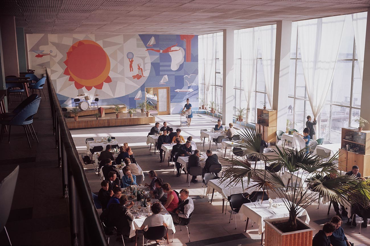 People visit a restaurant inside a river terminal in Omsk city, located at the confluence of the Om and Irtysh rivers, 1968.