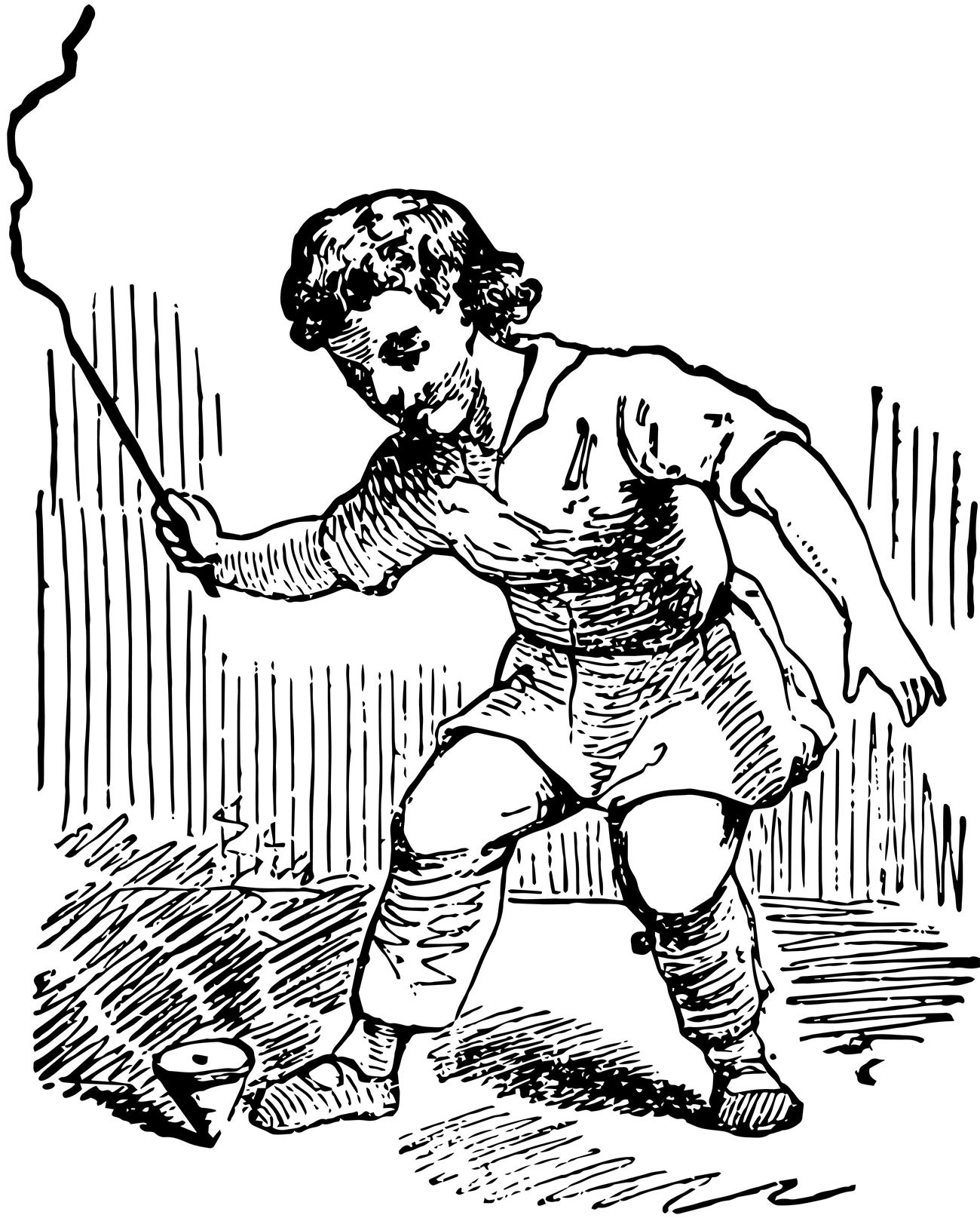 A boy playing a whipping top.