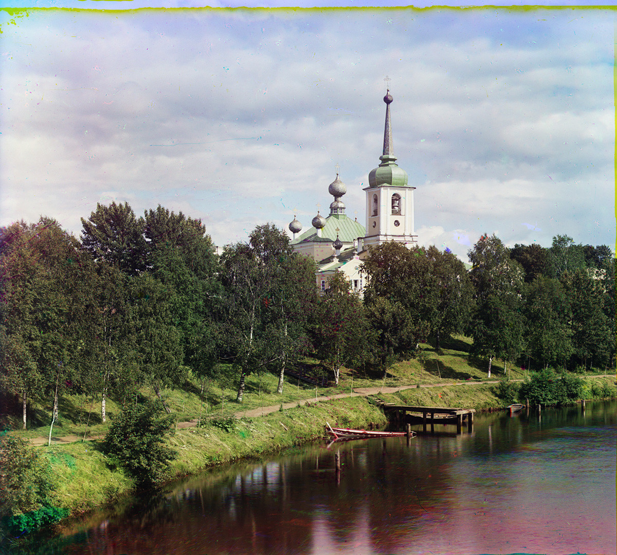 Vytegra River. View from Sivers Bridge with towpath of St. Sergius Lock. Background: bell tower & Resurrection Cathedral (1796-1800), northwest view. Summer 1909