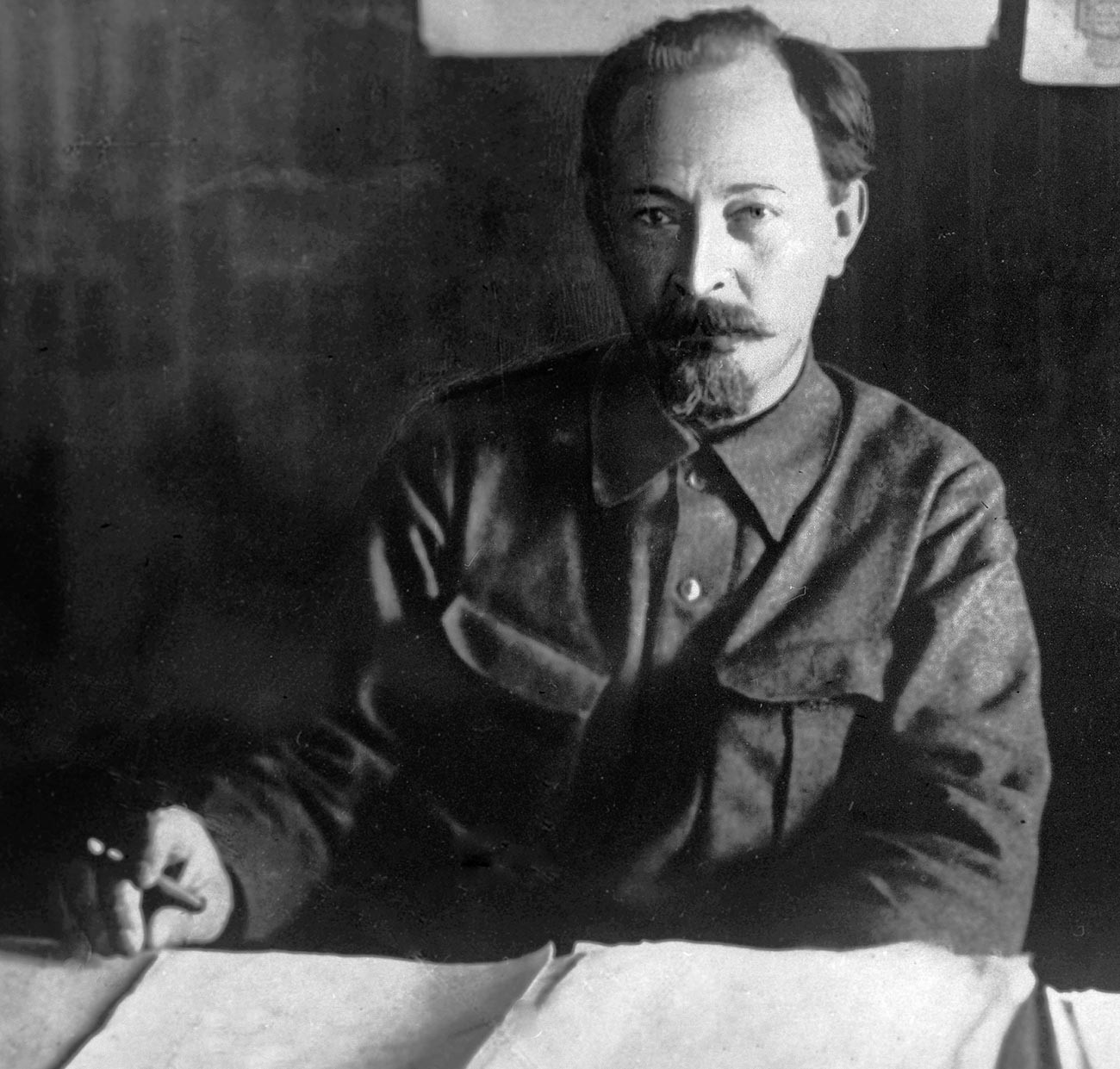 Felix Edmundovich Dzerzhinsky at his desk.