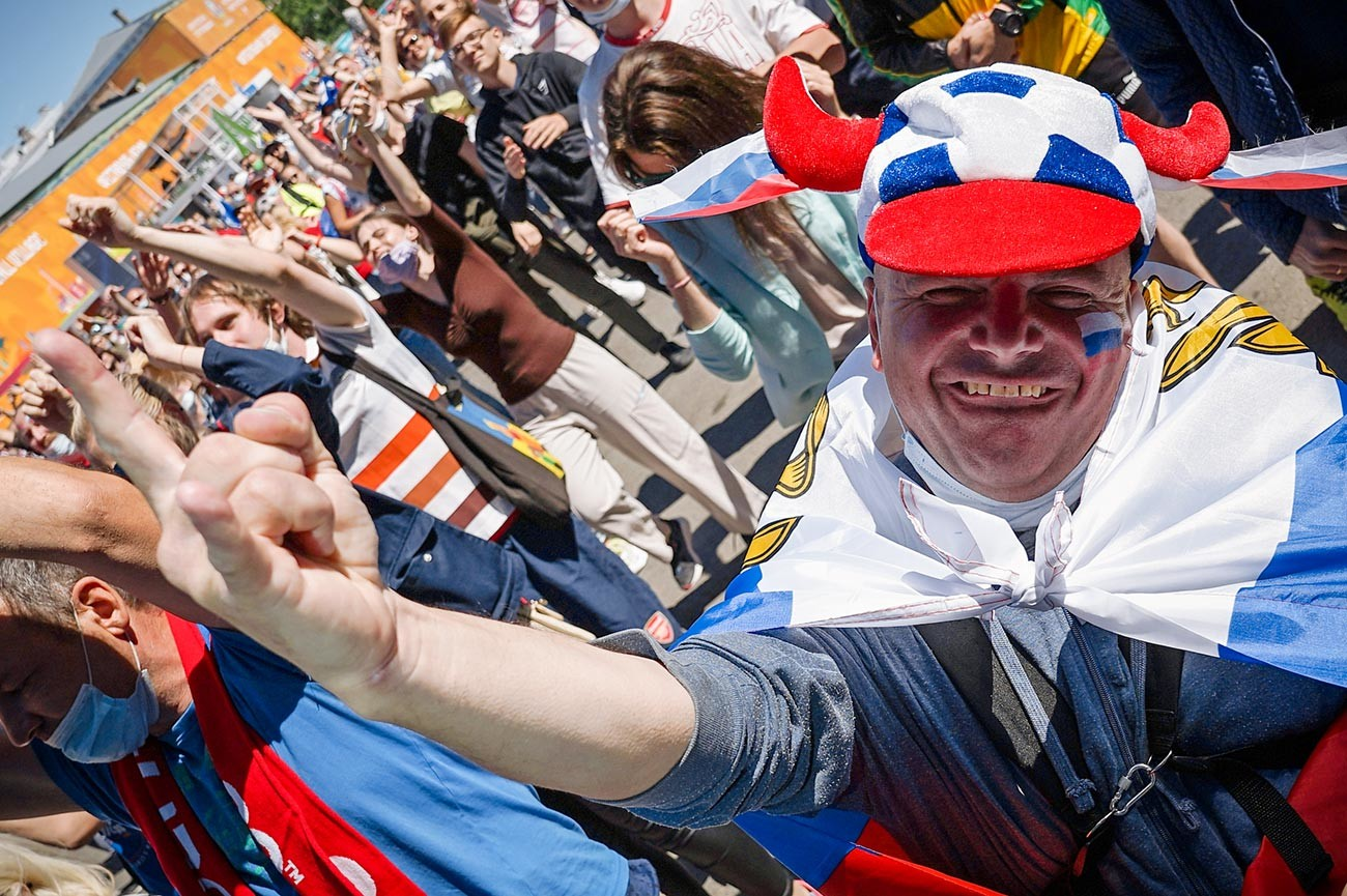 Fans during the broadcast of the match of the 2nd round of the group stage of the European Football Championship 2020 between the national teams of Finland and Russia in the UEFA Euro 2020 football village in St. Petersburg