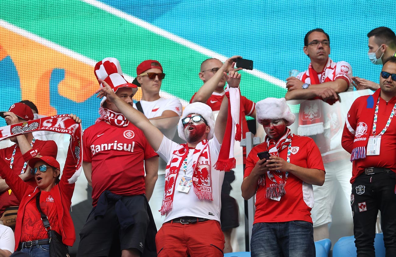 Fans of Poland show their support prior to the UEFA Euro 2020 Championship Group E match between Poland and Slovakia at the Saint Petersburg Stadium on June 14, 2021 in Saint Petersburg, Russia