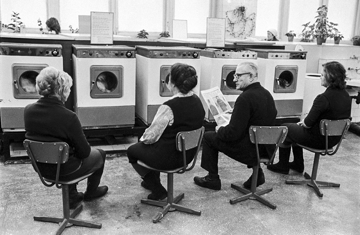 People wait for their wash at the laundry, Novosibirsk, 1973.