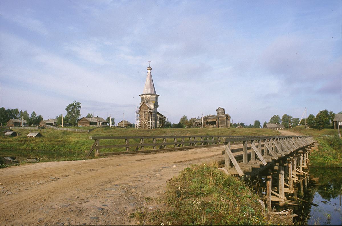 Saminsky Pogost. View of Church of Elijah the Prophet from wooden bridge across Samina River. August 28, 2006
