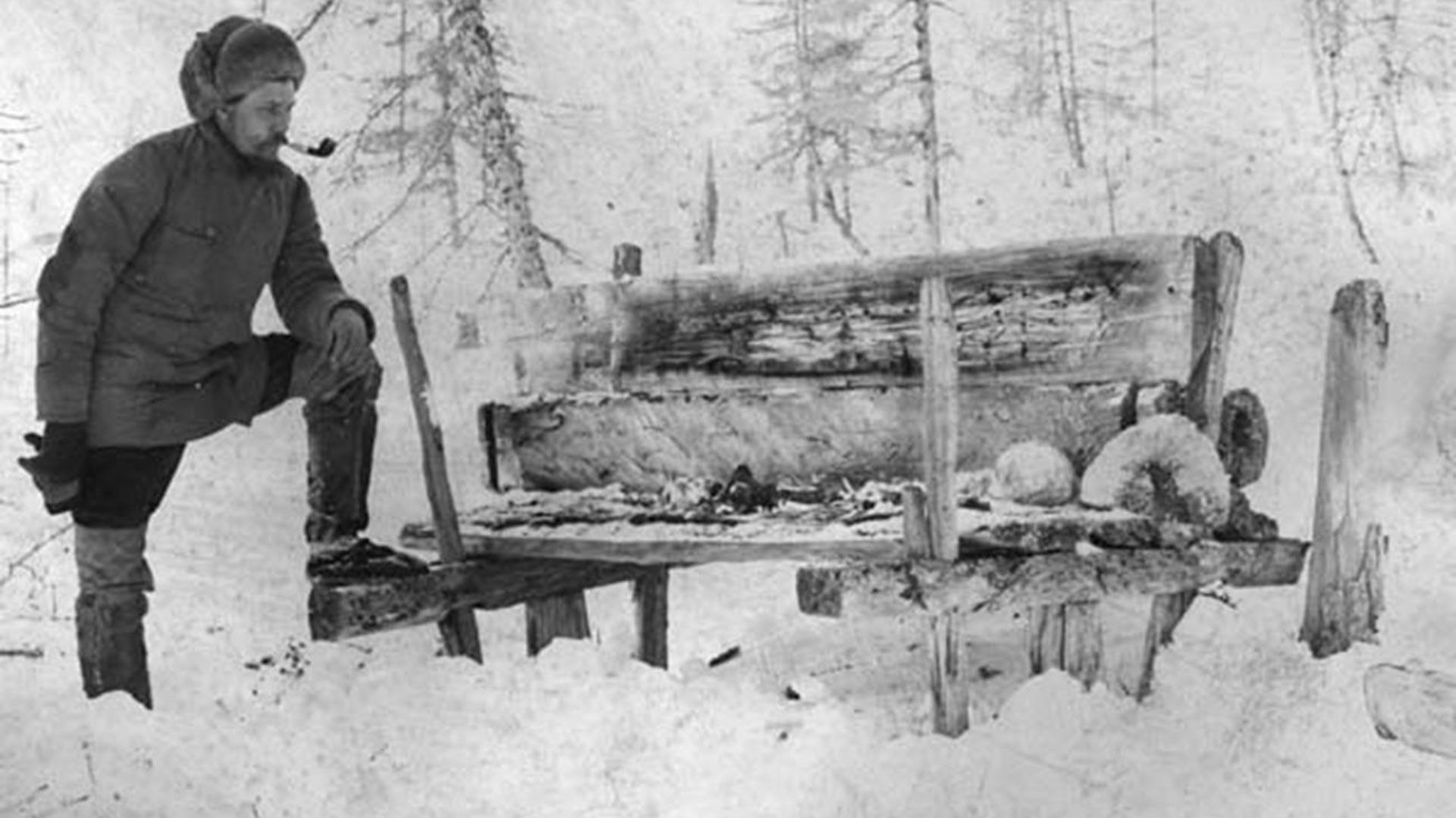 Ethnographer V. Vasilyev and a Yakut above-the-ground burial in Yenisey region, Siberia, 1905