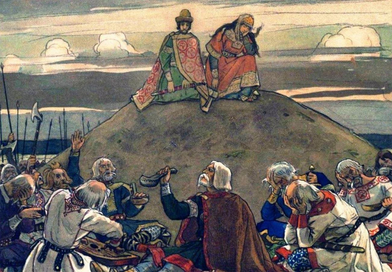 « Le festin funèbre d'Oleg le Sage », par Viktor Vasnetsov, 1899. Les parents du prince sont en deuil au-dessus du kourgane fraîchement créé, tandis que les guerriers et les amis d'Oleg boivent et pleurent en dessous.