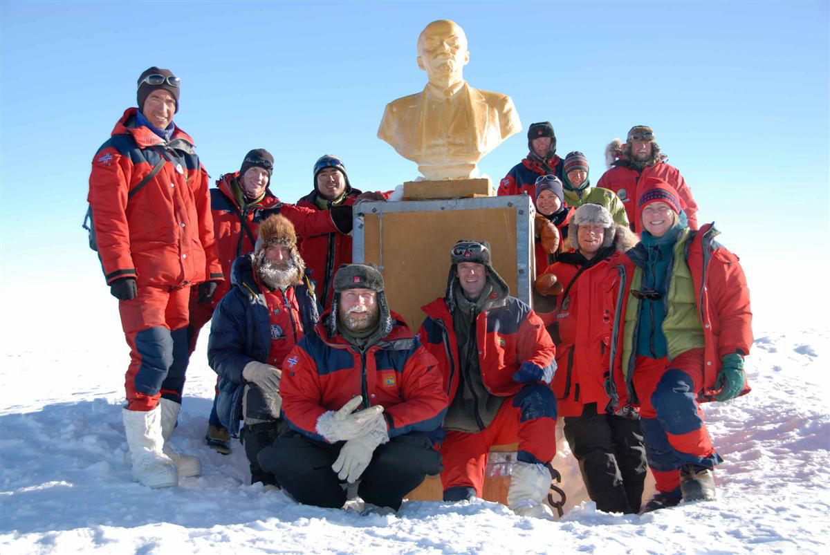 The Norwegian-US Traverse team poses with Lenin's bust.