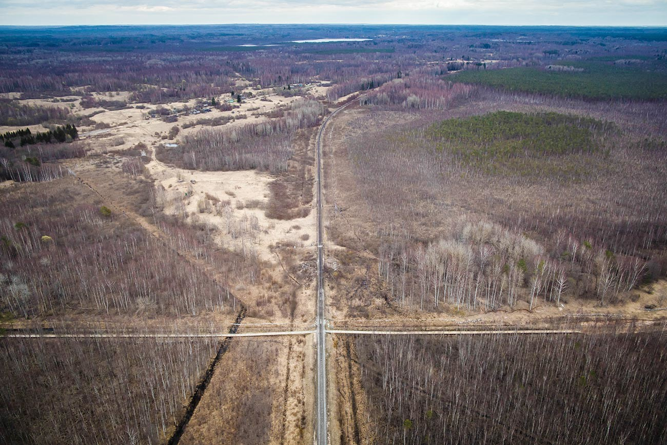 This aerial view shows the Latvian-Russian border and a crossing railway track near Ludza.