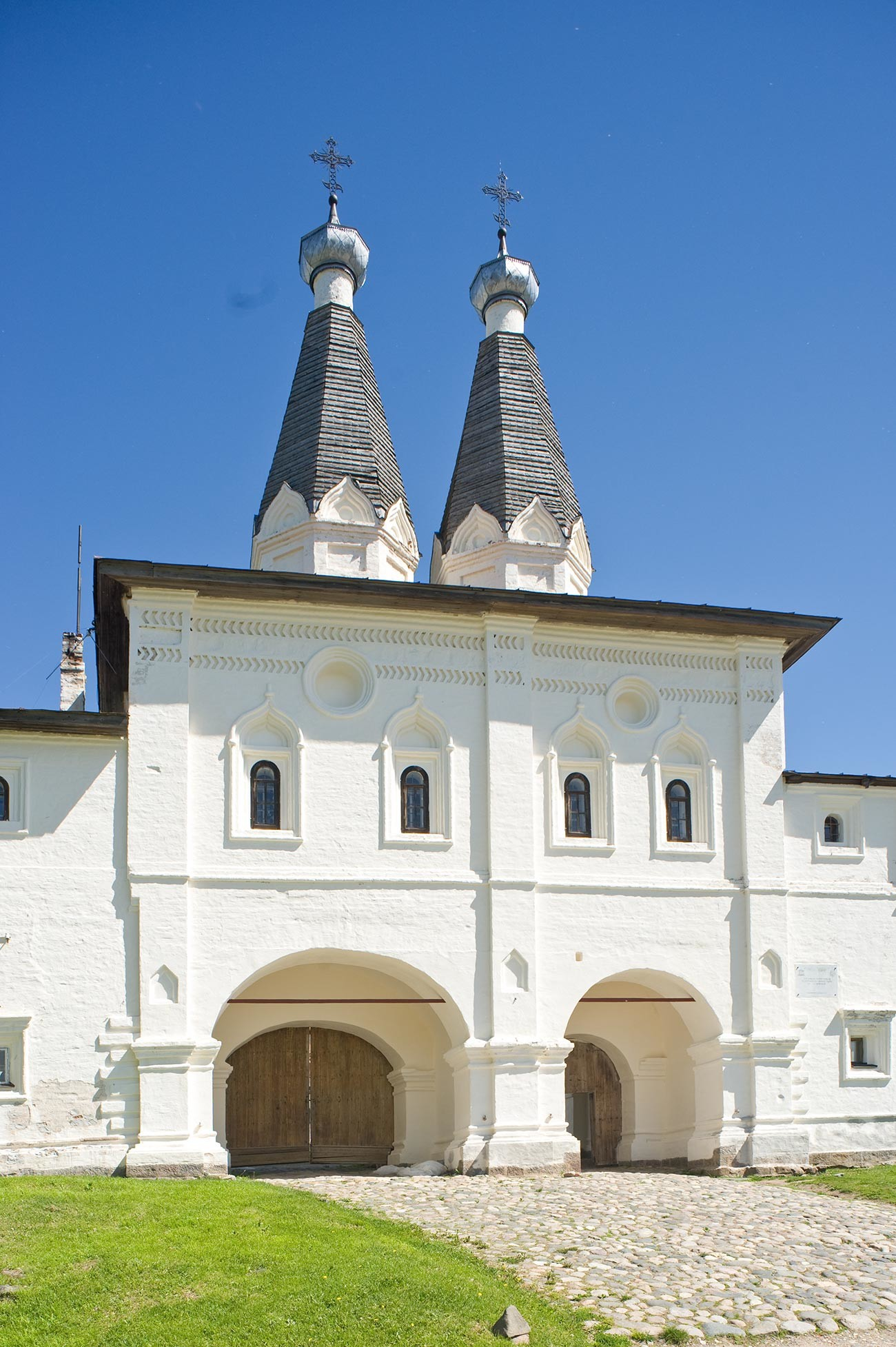 Ferapontov Monastery. Holy Gate with Churches of Epiphany & St. Ferapont. West view. June 1, 2014