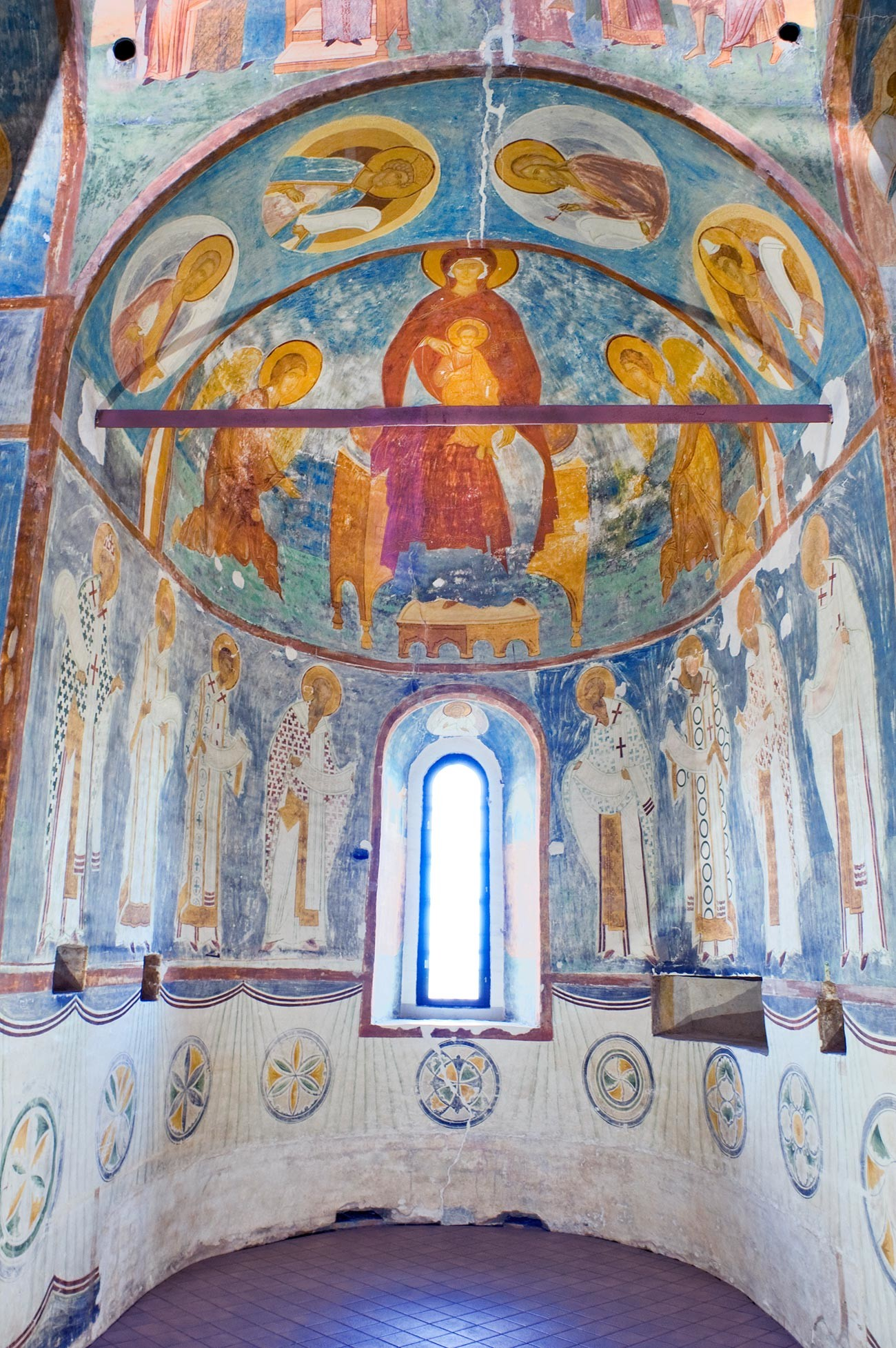 Cathedral of Nativity. Central apse (for main altar). Fresco of Mary enthroned with Archangels Gabriel & Michael. Lower row: Church Fathers at liturgy. Foreground: iron tie rod stabilizing the walls. June 1, 2014