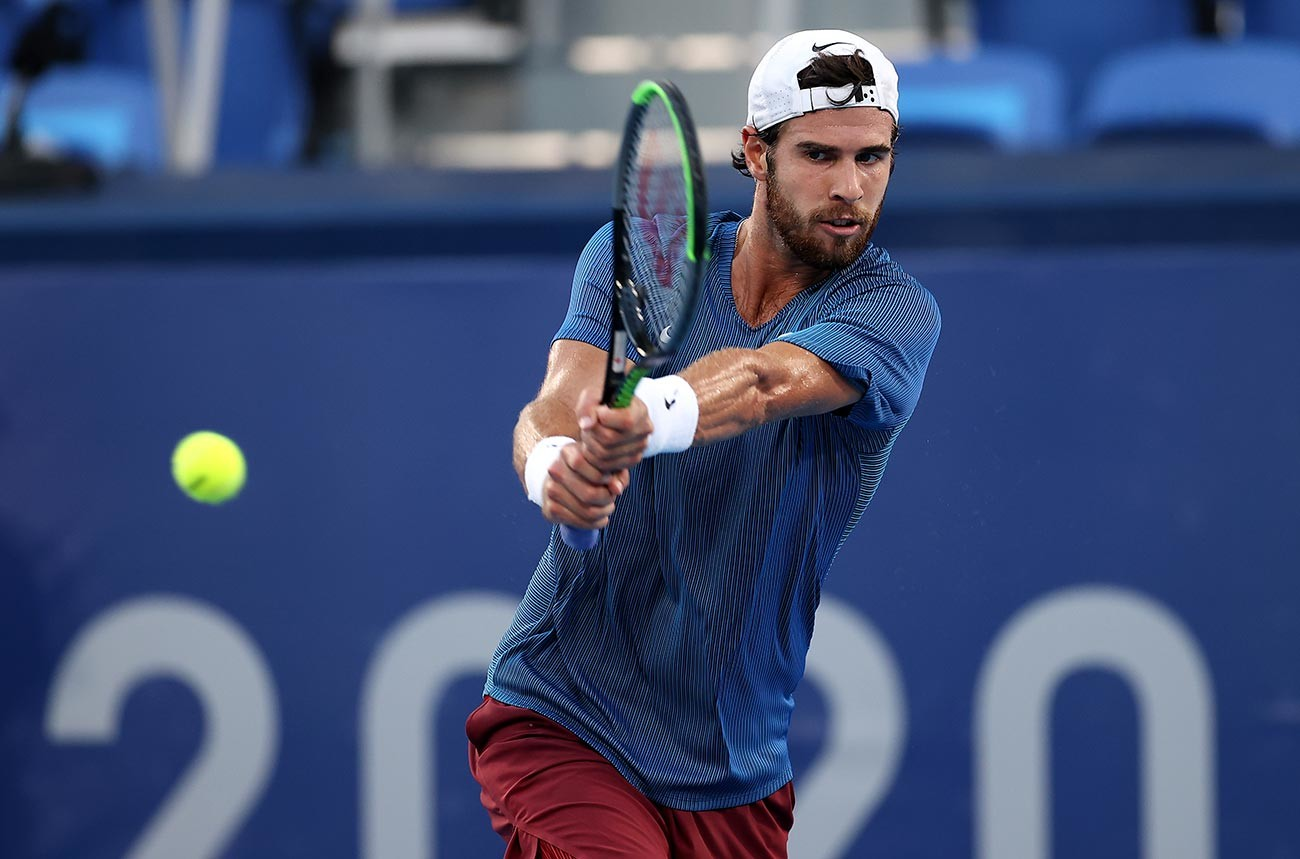 Karen Khachanov of Team ROC plays a backhand during his Men's Singles Gold Medal match against Alexander Zverev of Team Germany on day nine of the Tokyo 2020 Olympic Games at Ariake Tennis Park on August 01, 2021 in Tokyo, Japan