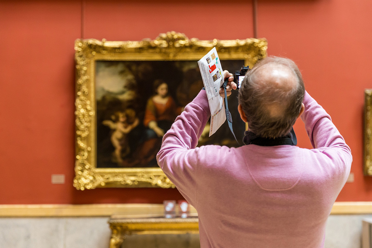 A visitor taking photos at the Hermitage museum