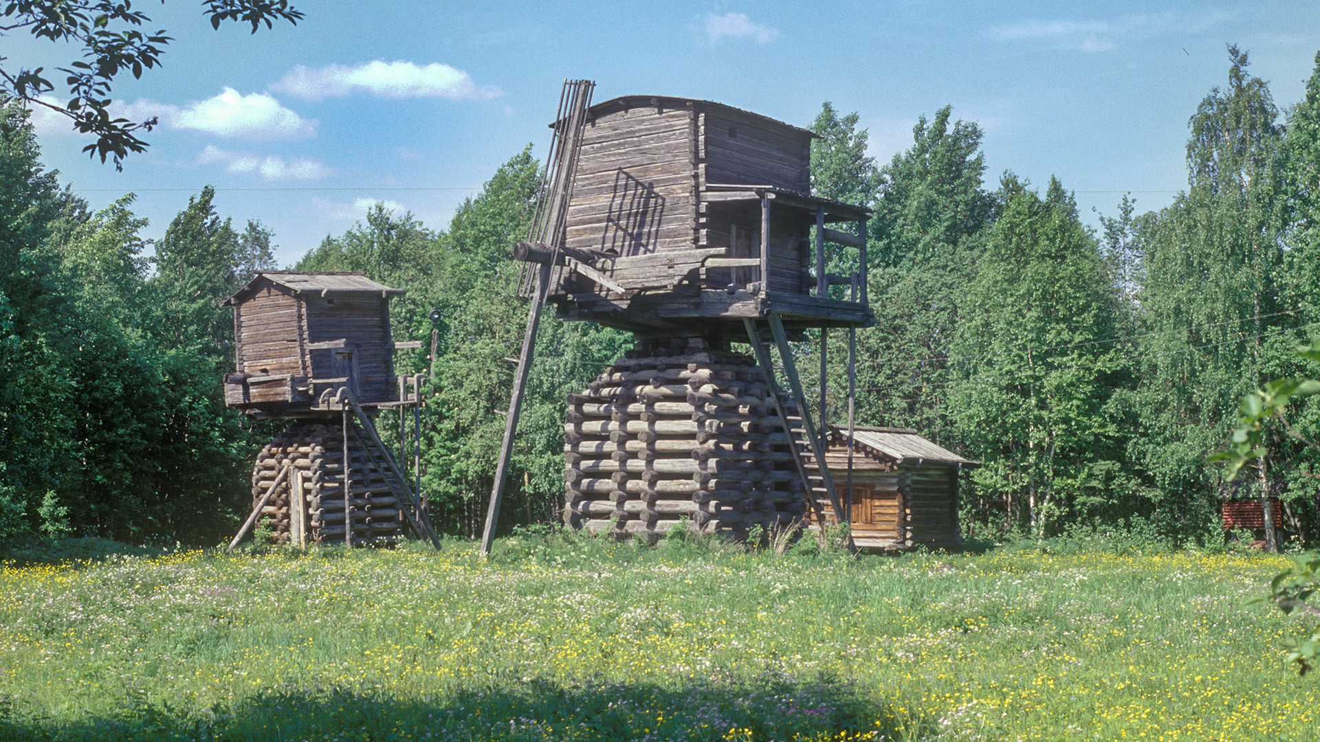 Malye Korely Museum. Elevated post windmills, originally at Tselegora village (Mezen Region). June 22, 1999