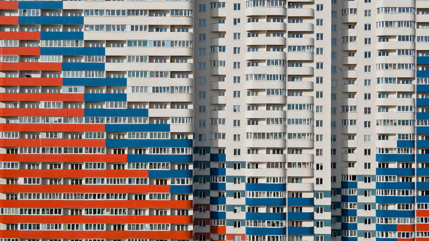 A view shows an apartment block with a facade, depicting the colours of the Russian state flag in Saint Petersburg, Russia.