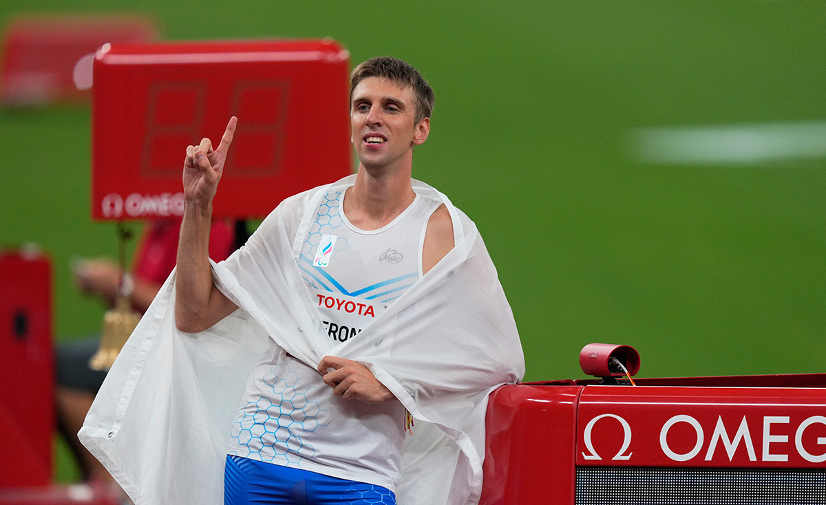 Dmitrii Safronov from Russia winning gold and beating world record during athletics at the Tokyo Paralympics, Tokyo Olympic Stadium, Tokyo, Japan