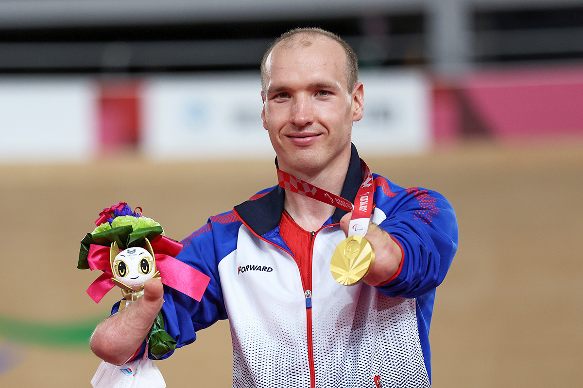 Gold medalist Mikhail Astashov of Team RPC celebrates on the podium during the medal ceremony for the Track Cycling Men's C1 3000m Individual Pursuit Final on day 2 of the Tokyo 2020 Paralympic Games at Izu Velodrome on August 26, 2021 in Izu, Shizuoka, Japan