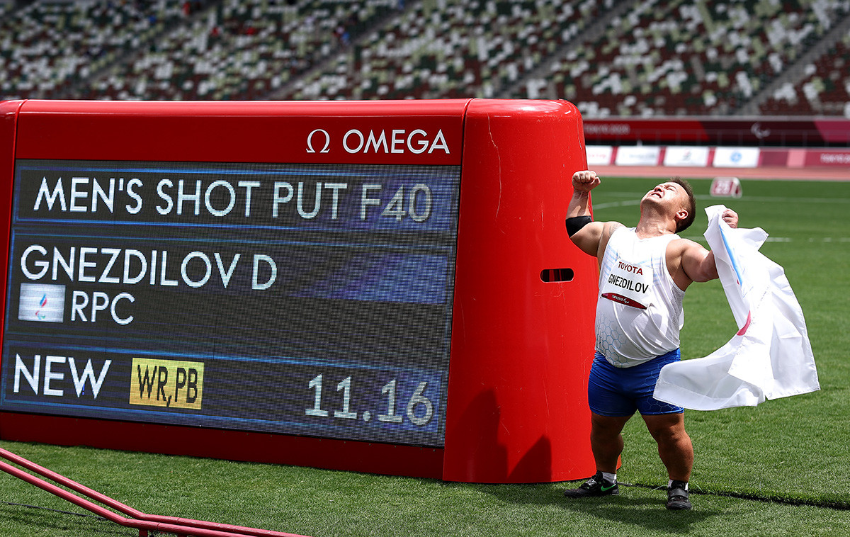 Denis Gnezdilov of Team Russian Paralympic Committee reacts after winning gold medal and breaking the World record in Men's Shot Put - F40 on day 5 of the Tokyo 2020 Paralympic Games at Olympic Stadium on August 29, 2021 in Tokyo, Japan