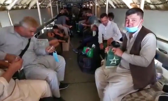 Passengers in the cabin of the IL-76MD cargo aircraft during the evacuation of Russian citizens from Afghanistan.