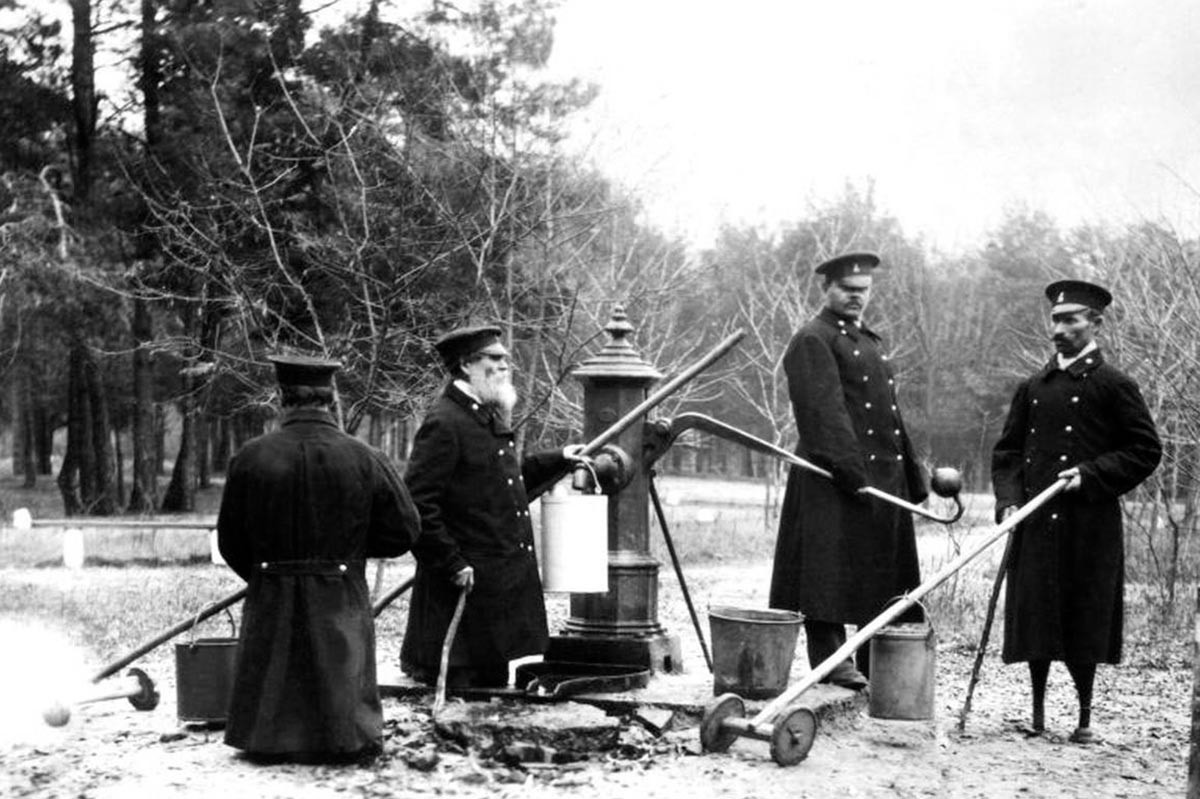 Disabled people at the well. The Western branch of the House of Emperor Alexander II for disabled railway employees. 1901.