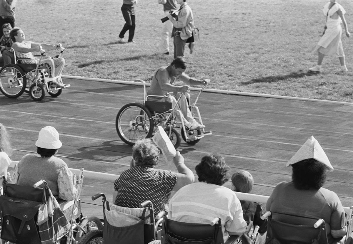 A disabled person takes part in a race on wheelchairs, Crimea, 1989.