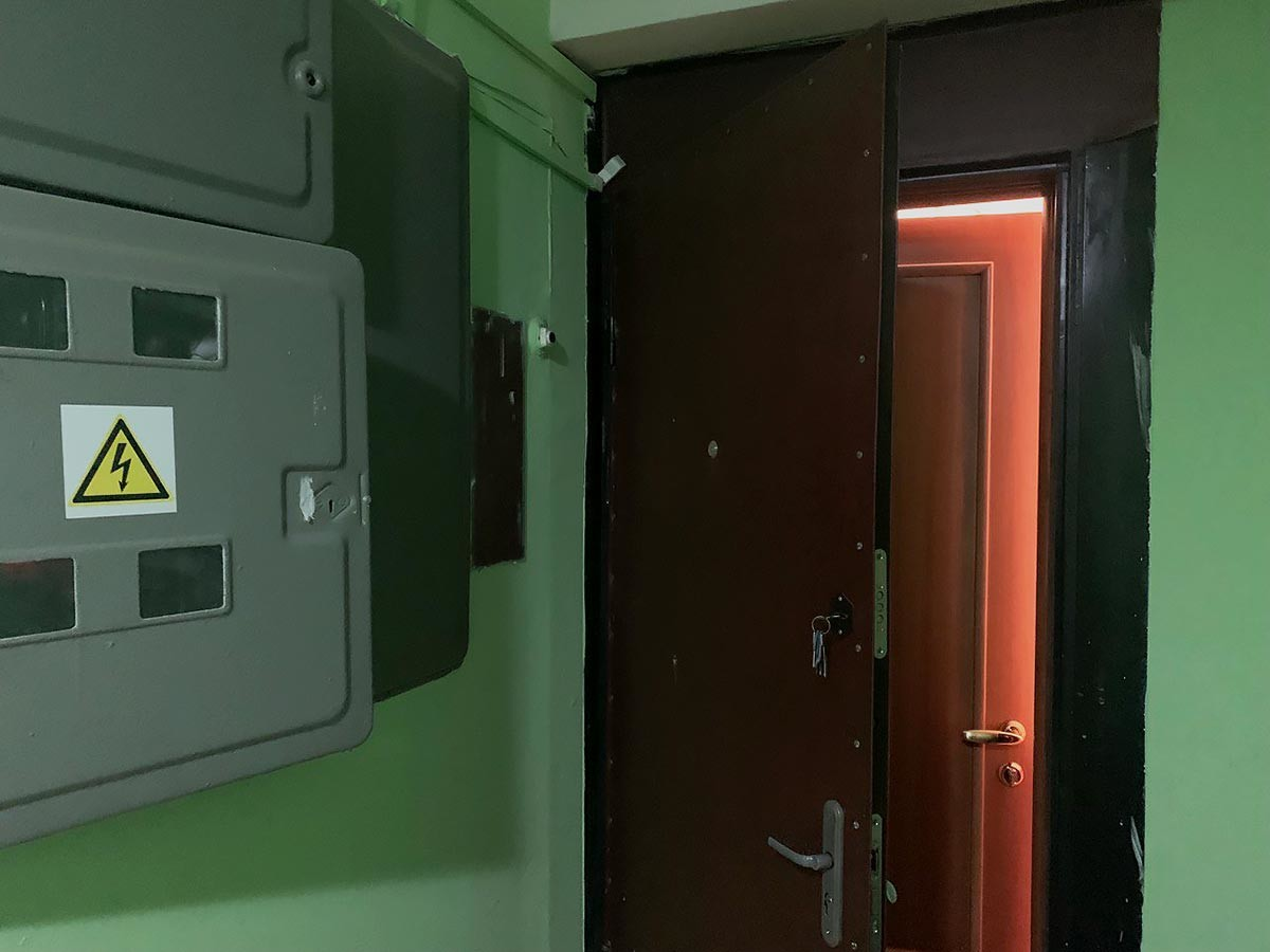 A double front door in an apartment house.