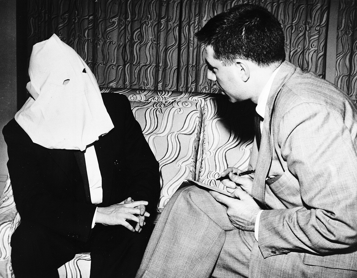 Igor Gouzenko, former Russian cypher clerk who revealed a Soviet spy ring in Canada in 1945, wears a hood to conceal his face, during a n interview with Associated Press writer Saul Pett, in Canada, on April 29, 1954.