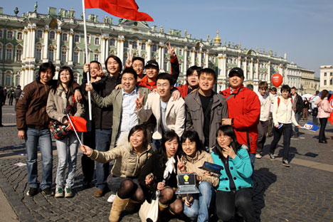 Chinese tourists taking pictures in front of the State Hermitage in St. Petersburg. Source: Photoxpress