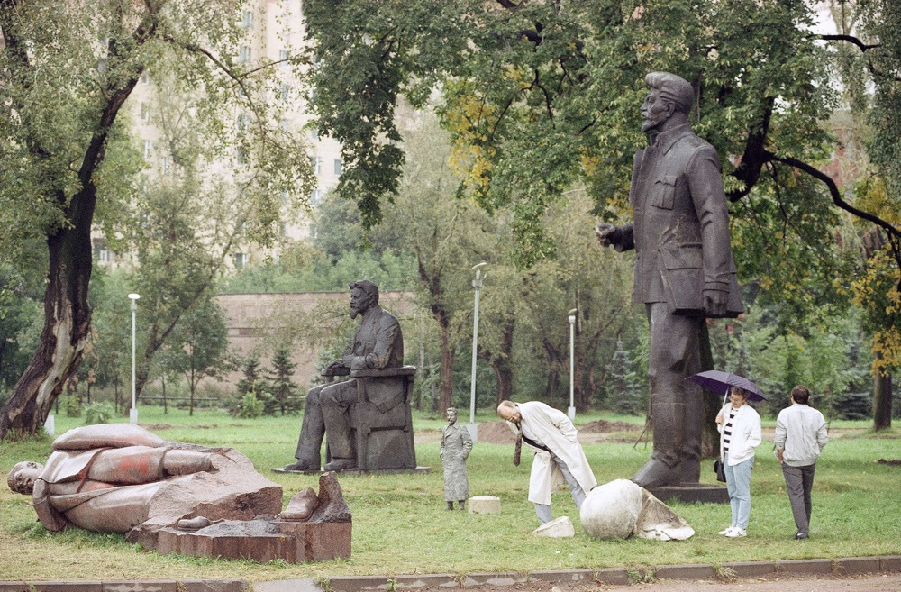 Tourists stroll among statues of former Soviet Communist leaders near Gorky Park, some which were toppled after the failed coup. Moscow. Sept. 6, 1991.