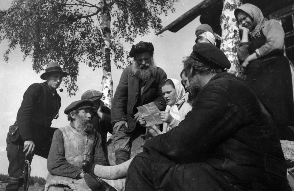 1945, Russian civilians reading of a victory during World War II.