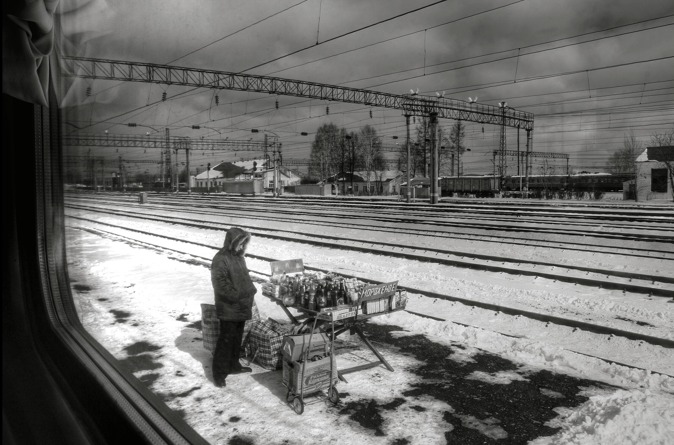 The train trundles past small villages and dachas and then stops in a cacophony as people run down the carriages selling toys, beer, dried fish, meat pies and ice cream.
