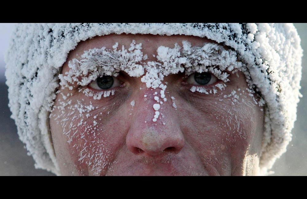 A participant runs during a traditional Christmas Half Marathon in Omsk at air temperatures of  -30 C.