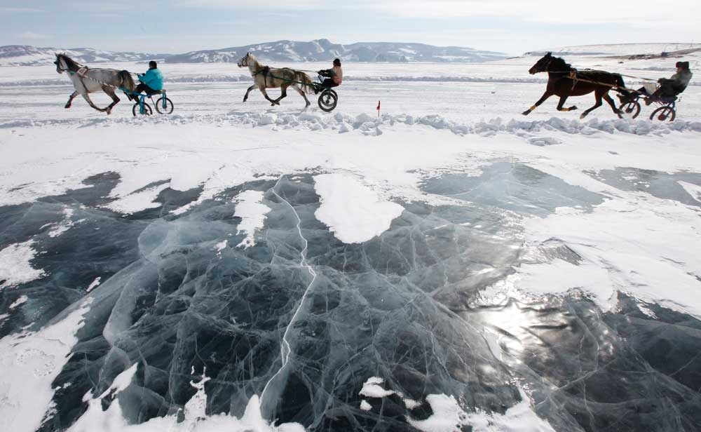 Riders compete on the frozen Yenisei river during the Ice Derby amateur horse race, which has been held annually at the end of each winter since 1969.