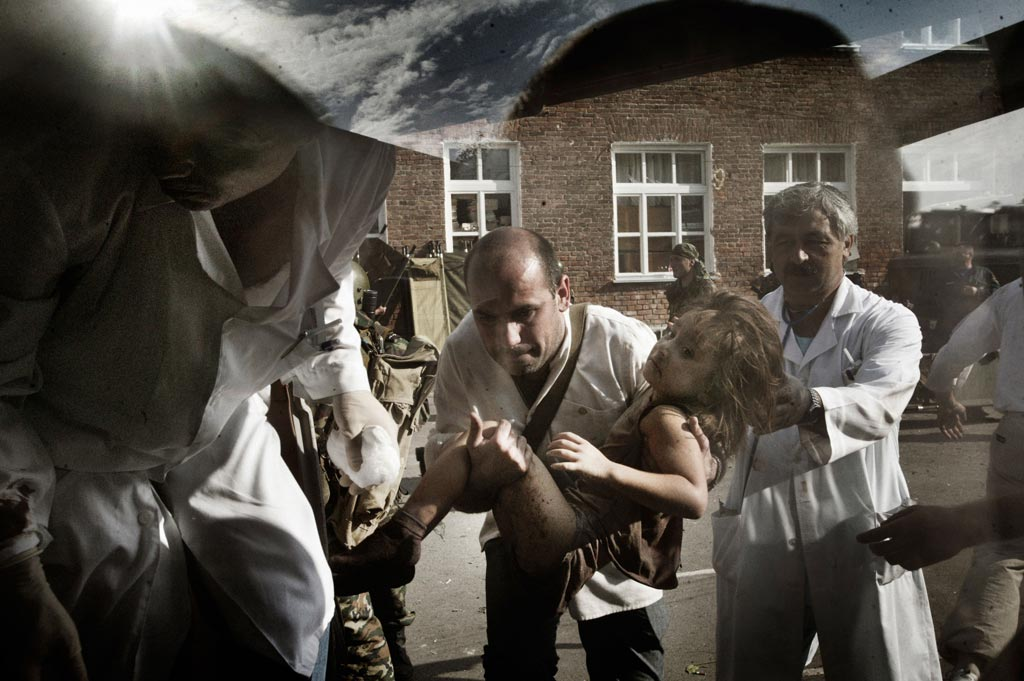 "2004, Yuri Kozyrev, 2nd prize, Spot News: ""Tragedy in Beslan. After the release"" series. The terrorist invasion of School No. 1 in Beslan. North Ossetia, Beslan, 3 September 2004."