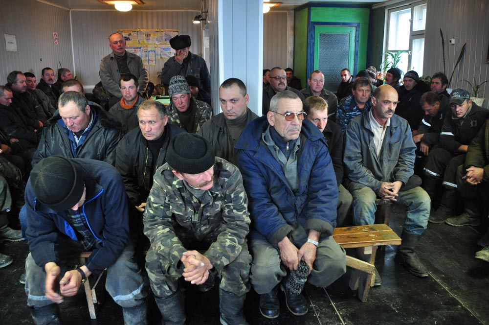 In a few minutes, these morose-looking men will set off to mine gold. Their shift lasts six months, followed by six months at home and then back to Chukotka. Many have lived this way for decades.