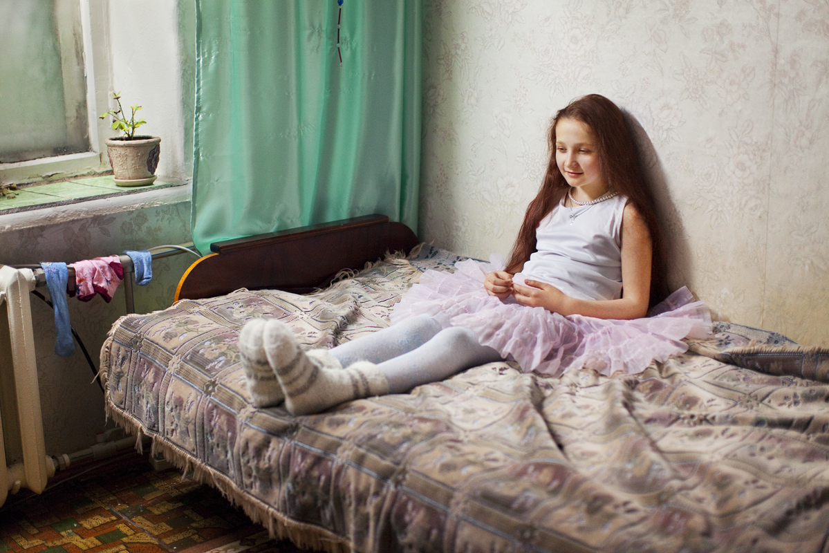 """I met Tanya, a young girl who reminded me of myself when I was a kid."" - Evgenia Arbugaeva"