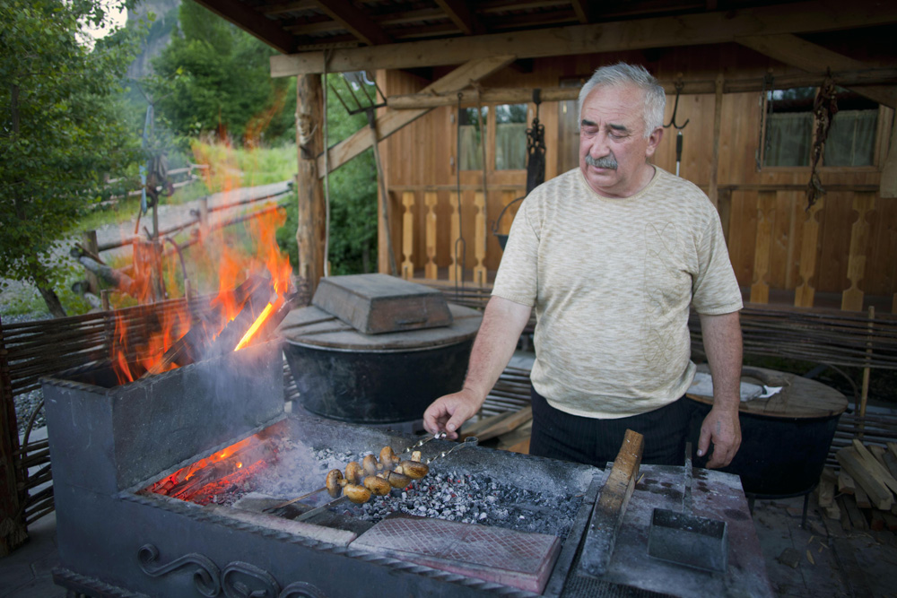 "Preparing a ""shashlik"" (typical dish of the Caucasus cuisine) at the sunset"