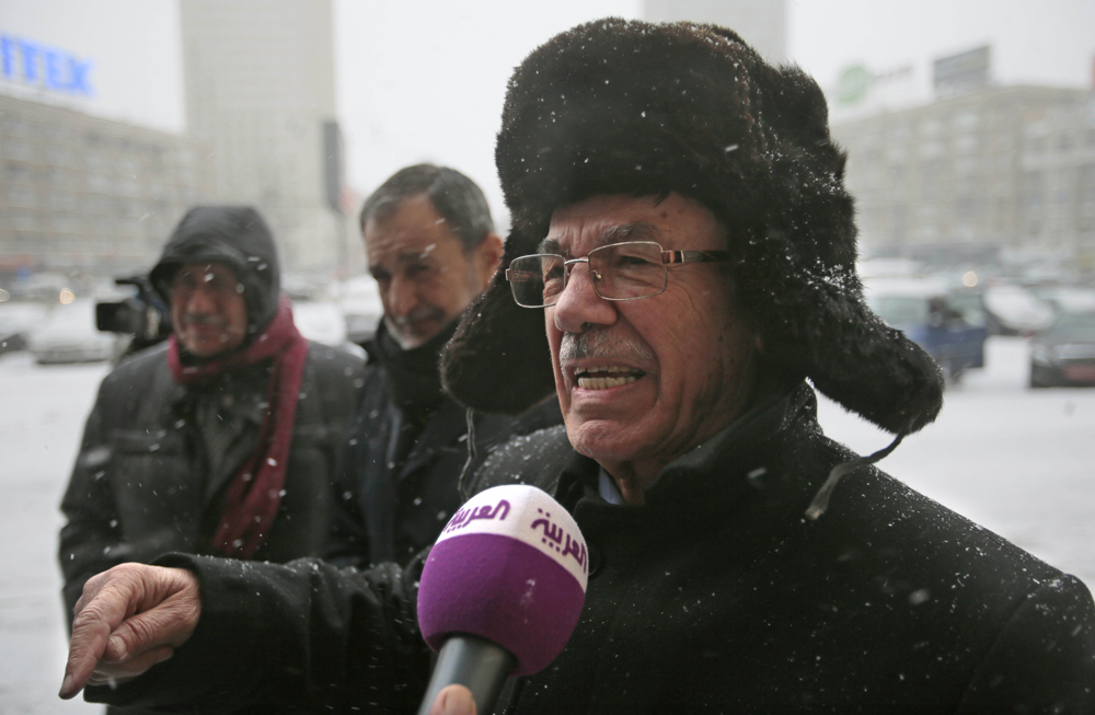 Syrian opposition member Hassan Abdul-Azim gestures as he speaks to reporters outside the Russian Foreign Ministry building in Moscow, Russia. Abdul-Azim and other opposition members held talks with Russian diplomats to discuss ways of settling the Syrian crisis.
